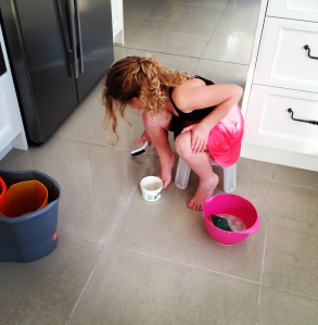 Cinderella cleaning the grout in the tiles and loving it